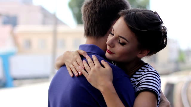 Young couple hugging near a railway video