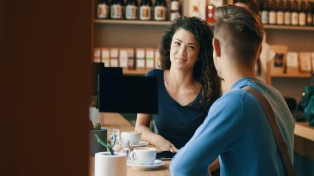 vídeos de stock e filmes b-roll de young couple in bar - coffee table