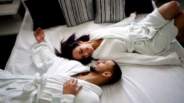 Young couple in bed video