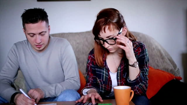 young couple in financial difficulties - foreclosure stock videos & royalty-free footage