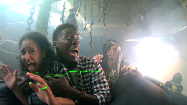Young couple in halloween haunted house with monster