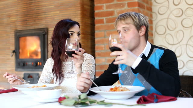 Young couple in restaurant (HD) video