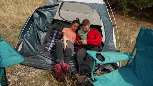 Young couple is relaxing in the camp