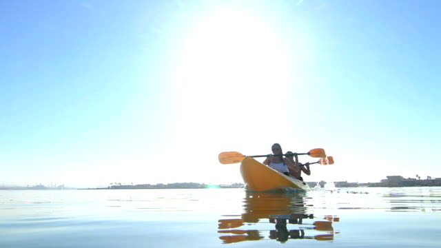 Young Couple Kayaking Outside In Summer video