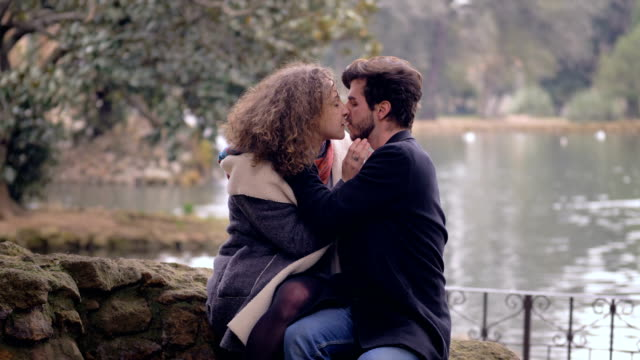 young couple kissing passionalety at park by the lake portrait of young couple kissing passionalety at park by the lake boyfriend stock videos & royalty-free footage