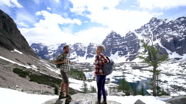 Young couple looking at views and contemplating nature video