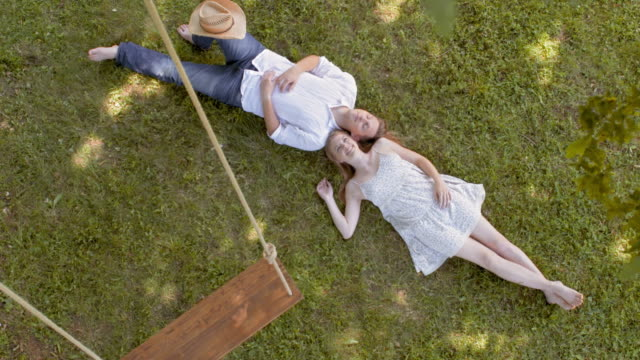 CS Young couple lying under a swing video
