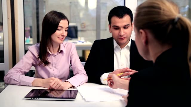 Young couple meeting with financial advisor video