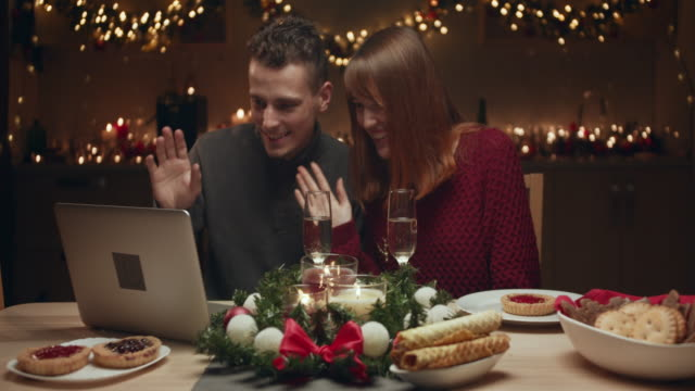 young couple meets christmas online. they communicate with relatives via the internet. - treedeo christmas stock videos & royalty-free footage