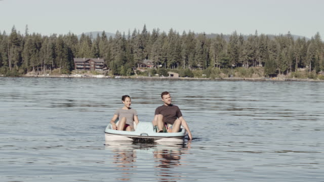 4K UHD: Young couple on a paddle boat video