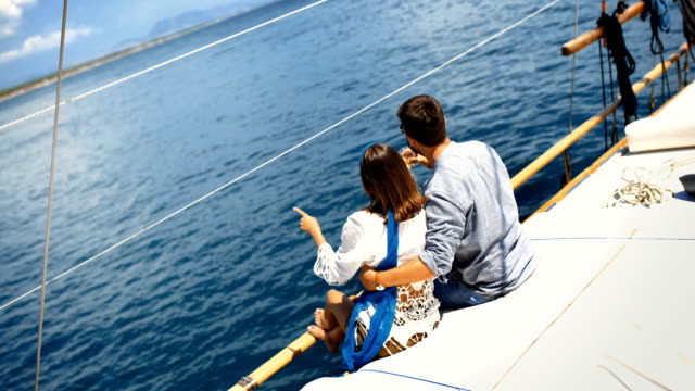 Young couple on a sailing cruise.
