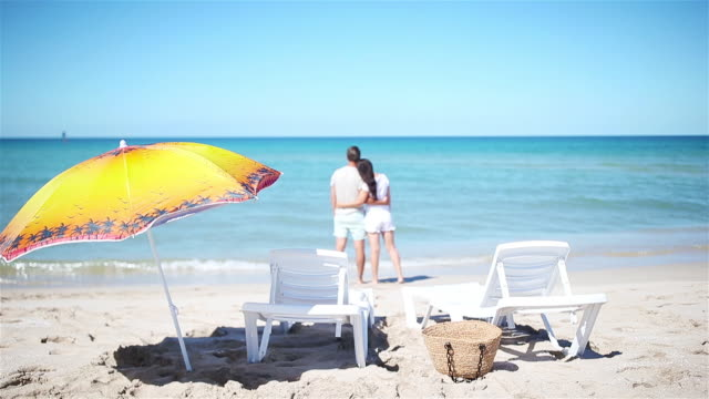 young couple on white beach during summer vacation - eastern european descent stock videos & royalty-free footage