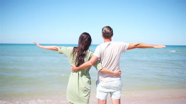 young couple on white beach during summer vacation. - eastern european descent stock videos & royalty-free footage