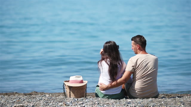 young couple on white beach during summer vacation. - wschodnio europejski filmów i materiałów b-roll