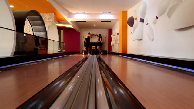 young couple playing Bowling video