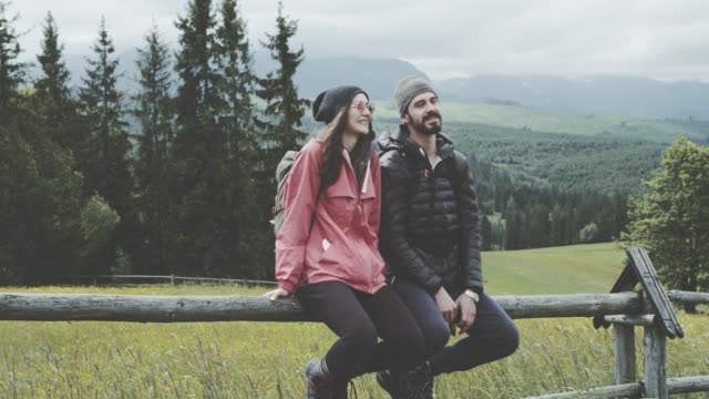 Young couple relaxing in the mountains video