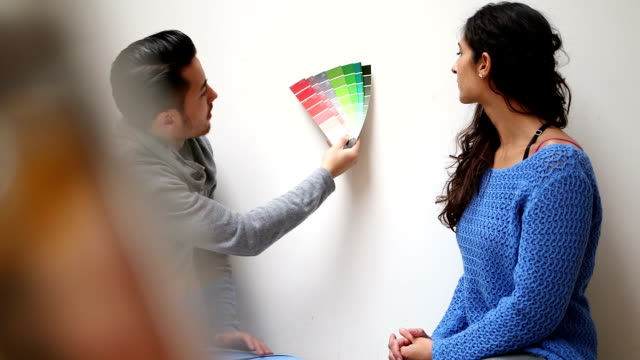 Young couple selecting paint colour samples video
