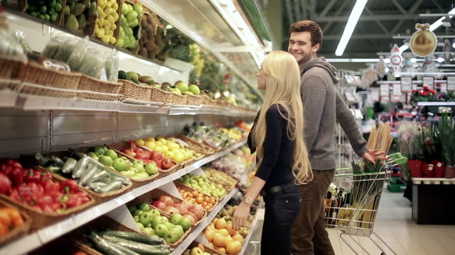 Young couple shopping in a supermarket video