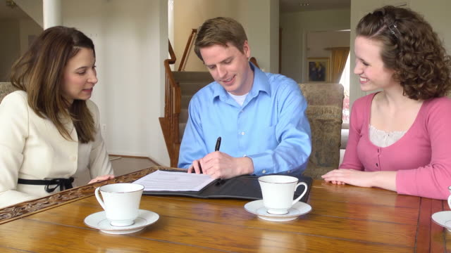 Young Couple Sign Document with Female Professional video