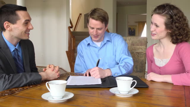 Young Couple Sign Document with Male Professional video