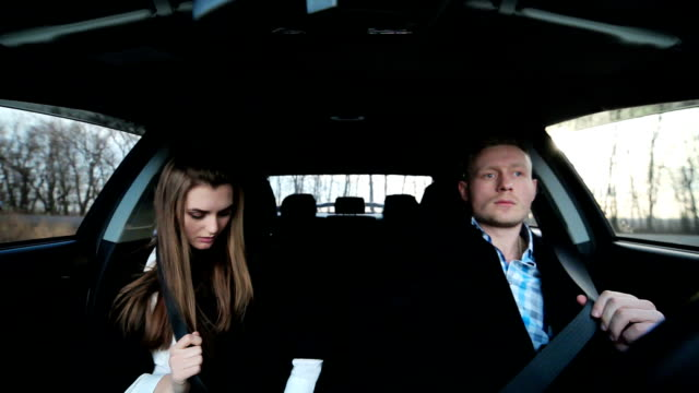 A young couple sits in car video