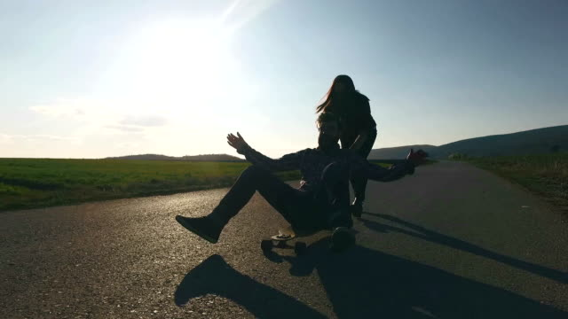 Young couple skateboarding in the street video