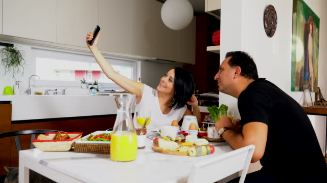 young couple taken selfie at home video