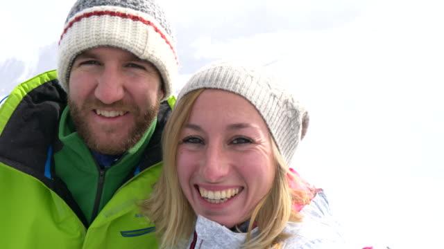 Young couple takin selfie on ski slope, Switzerland video
