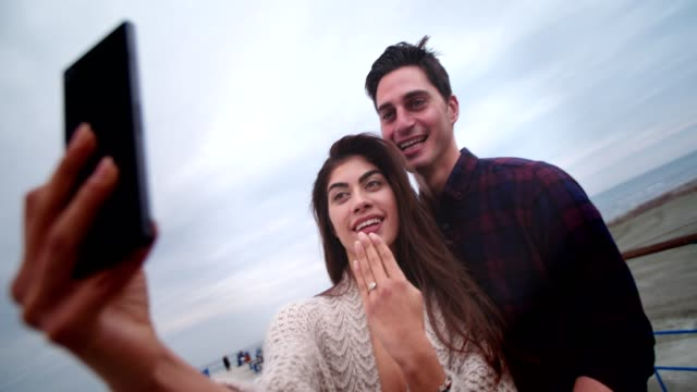 young couple taking an engagement ring selfie after marriage proposal - engagement stock videos & royalty-free footage