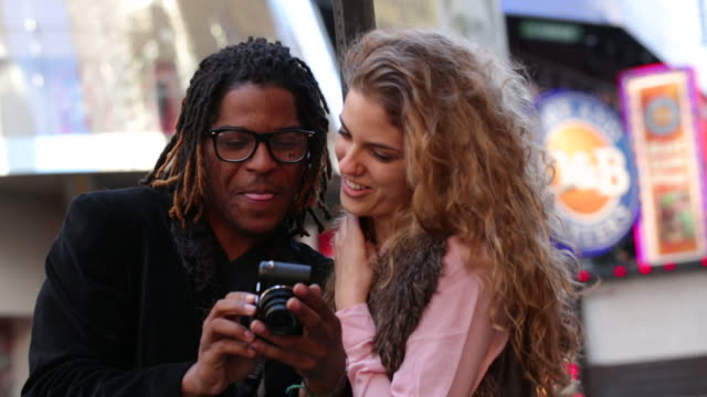 Young couple taking self portrait video