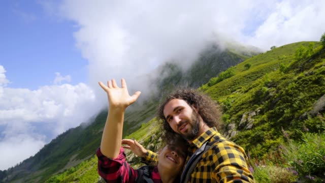 Young couple taking selfie in mountain