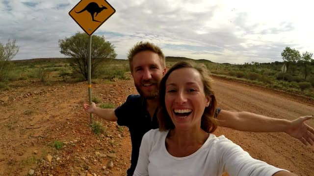 Young couple taking selfie with kangaroo sign, Australia video