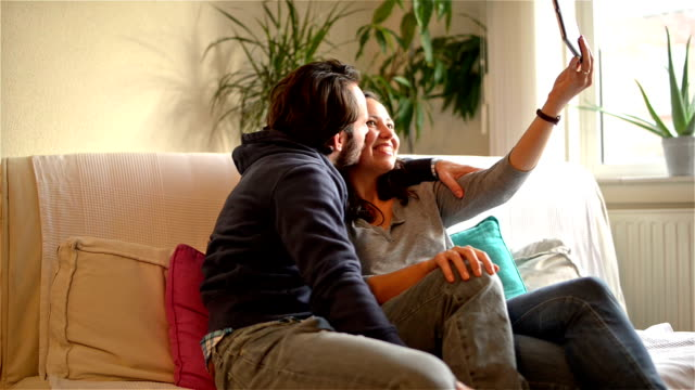 DOLLY HD: Young couple taking selfies at home video