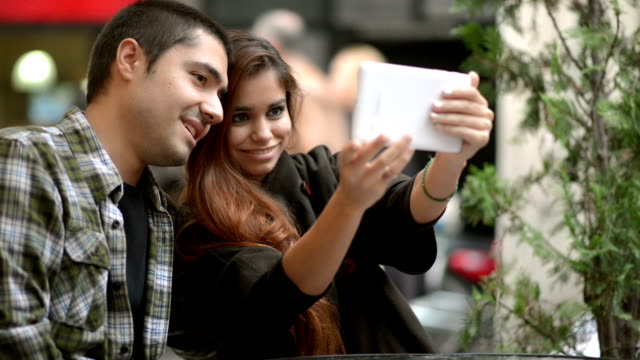 Young couple taking selfies video