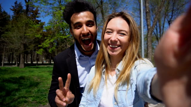 Young couple talking with psychologist by video call in slow motion video