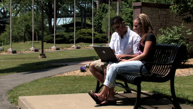 Young Couple Uses Laptop video
