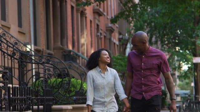 Young Couple Walking Along Urban Street In New York City video