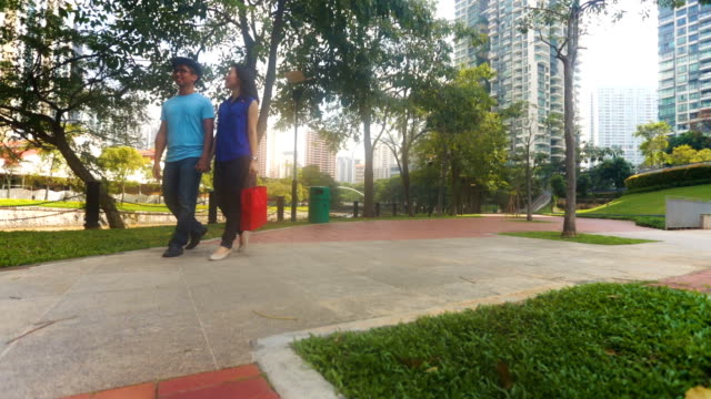 Young Couple Walking While Shopping in Singapore video