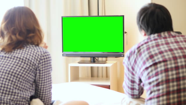 4K : Young Couple Watch Chromakey TV UltraHD (4K) : Young Couple Watch Chromakey TV watching tv stock videos & royalty-free footage