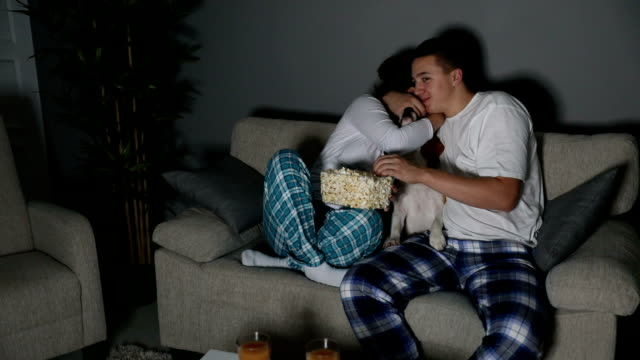 Young Couple Watching TV Together Young Couple Watching TV Together date night romance stock videos & royalty-free footage