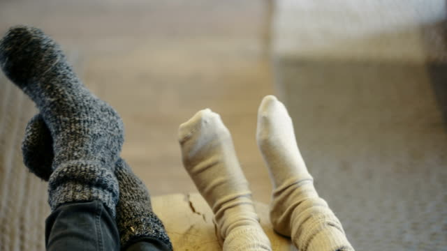 young couple wearing socks at home - calzino video stock e b–roll