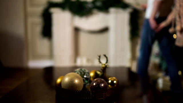 Young couple with Xmas tree. Blurred video