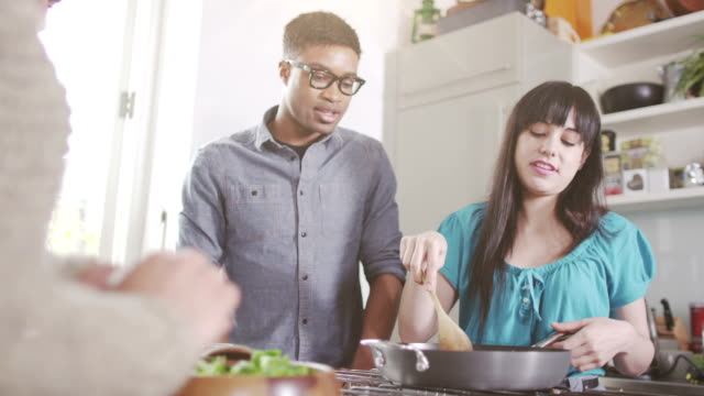 Young couples cooking together video