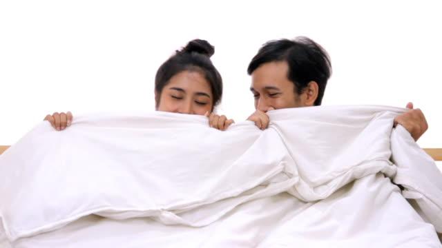 young couples under duvet in their bed.hd format. - kołdra filmów i materiałów b-roll