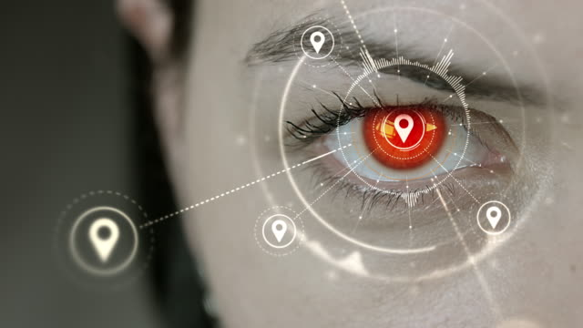 Young cyborg female blinks then location pin symbols appears. video