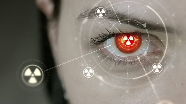 Young cyborg female blinks then nuclear symbols appears. video
