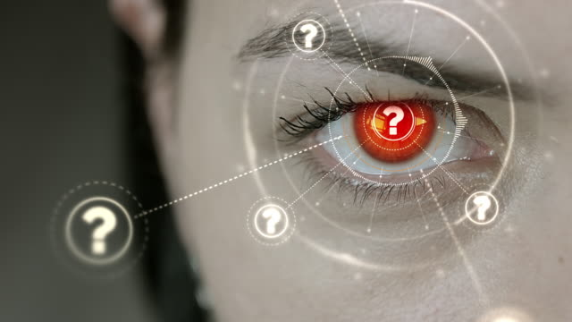 Young cyborg female blinks then question mark symbols appears.