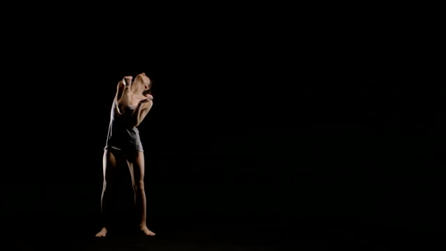 HD young dancer emotional black background video