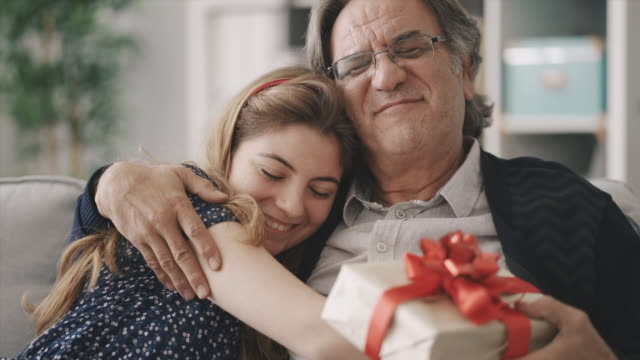 Young daughter gives her father a gift video