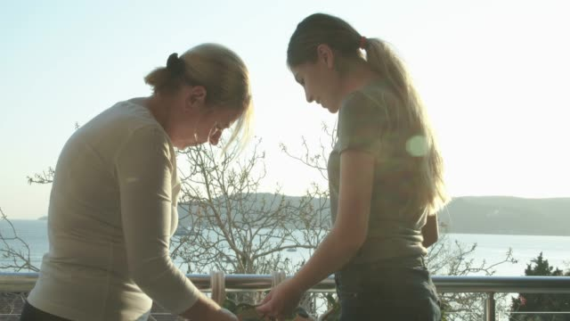Young daughter helps her mother